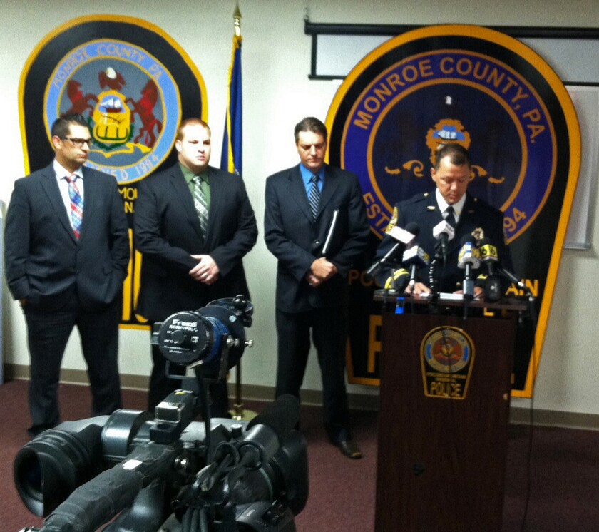 "From left, Pocono Mountain Regional Police Department Cpl. Lucas Bray, Det. Robert Miller, Monroe County Assistant Dist. Atty. Michael Rakaczewski and Police Chief Christopher Wagner speak during a Tuesday news conference in Pocono Summit, Pa., about plans to arrest 37 people in the December 2013 death of 19-year-old Chun ""Michael"" Deng."