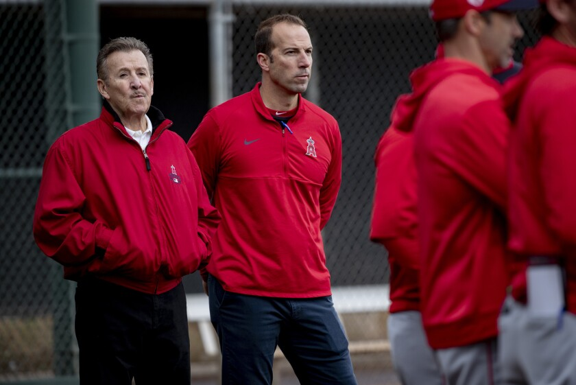 Angels general manager Billy Eppler, at middle with owner Arte Moreno, left, during spring training in February in Arizona.