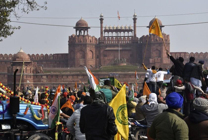 Protesting farmers arrive on tractors at New Delhi's historic Red Fort.