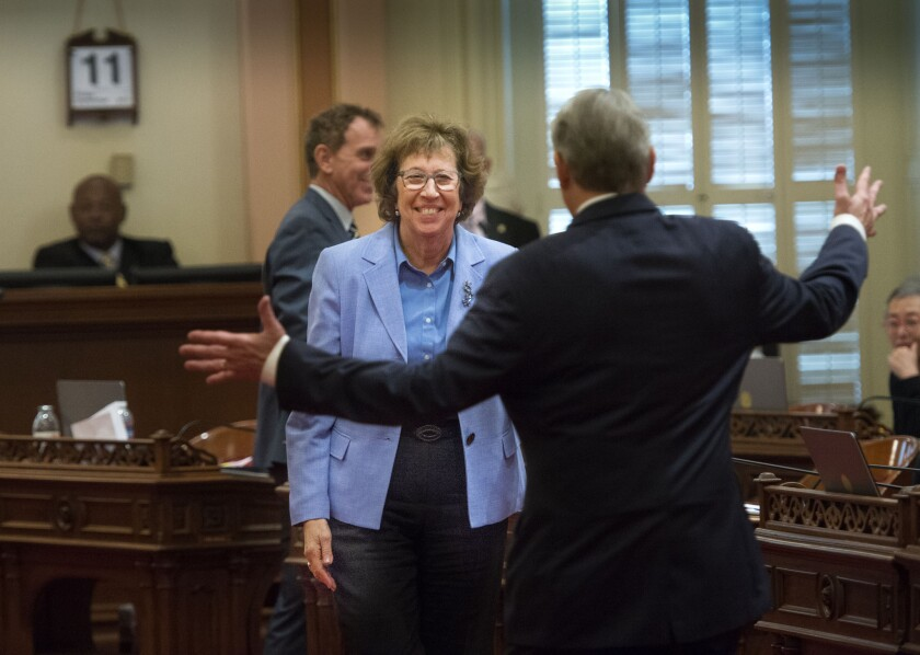Sen. Lois Wolk, D-Davis, and Sen. Bill Monning, D-Monterey, celebrate after the passage of legislation which would allow terminally ill patients to legally end their lives at the state Capitol on Sept. 11.