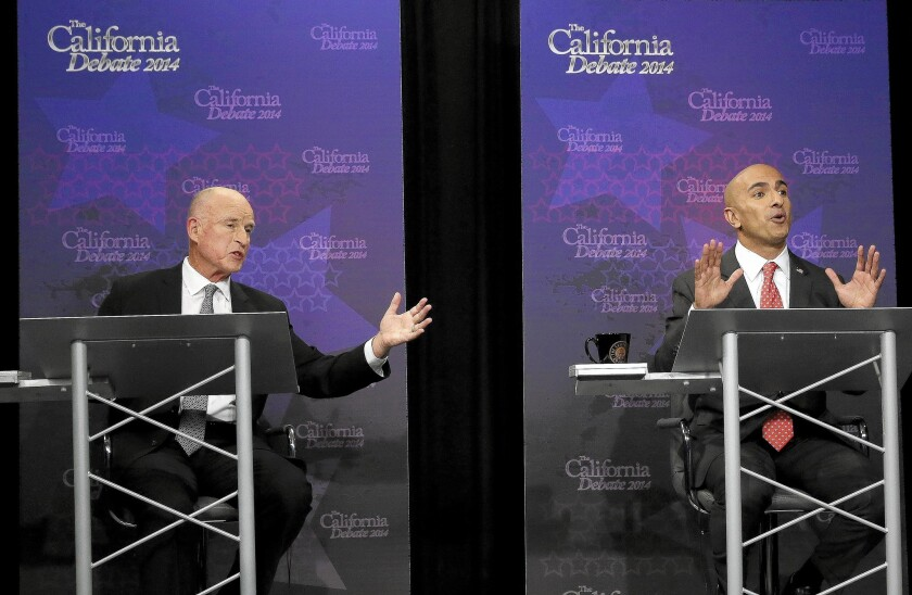 Gov. Jerry Brown, left, and Republican challenger Neel Kashkari speak during the Sept. 4 gubernatorial debate in Sacramento.