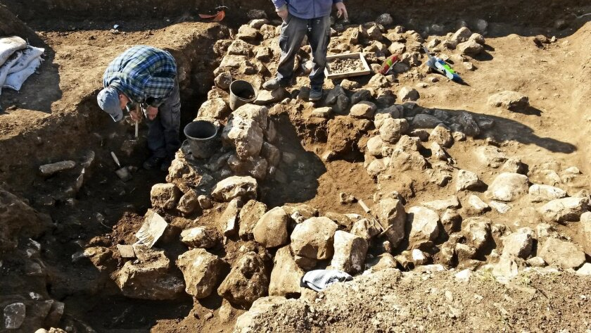 This handout photo released by the Israel Antiquities Authority on Wednesday, Feb. 15, 2016, shows work on uncovering of an ancient settlement in Jerusalem. Israeli archaeologists have discovered a 7,000-year-old settlement in northern Jerusalem in what they say is the oldest discovery of its kind