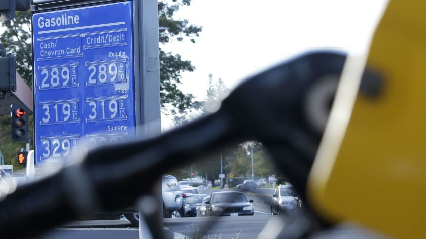 Gasoline prices are displayed at a Chevron station in Sacramento, Calif. on Oct. 30, 2017.