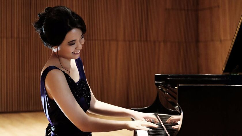Pianist Joyce Yang, who made her San Diego Symphony debut Friday night, exudes coolness at the keyboard.
