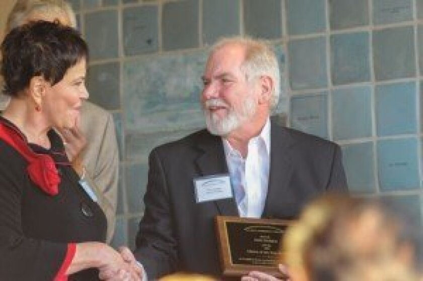 Tom Hodges is awarded the inaugural citizen of the year award at the La Jolla Community Center donor wall unveiling. Courtesy