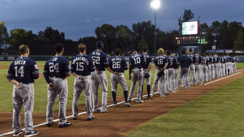 The Padres line up before a March 26, 2016, exhibition game against the Astros in Mexico City. The Padres will play a three-game, regular-season series with the Dodgers this season in Monterrey.