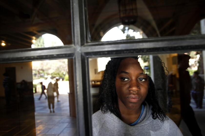 Student activist Janay Williams looks through a window from UCLA's Kerckhoff Hall. Williams is pushing for the school to require an undergraduate course dealing in topics of diversity.