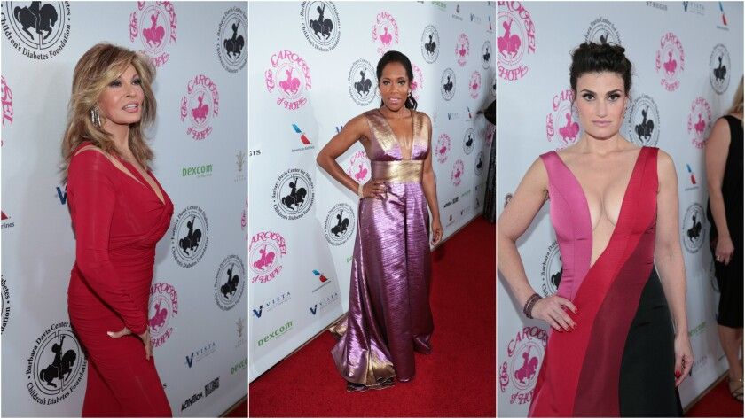 Raquel Welch, left, Regina King and Idina Menzel attend the 30th Carousel of Hope Ball in Beverly Hills.