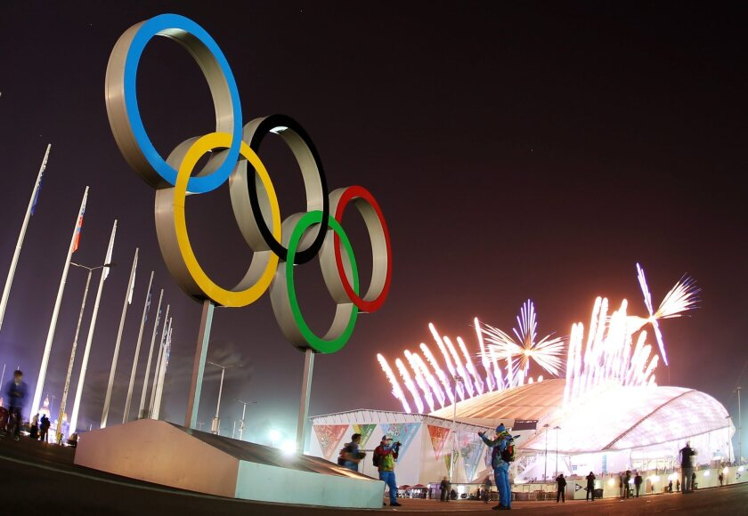 The Olympic Rings are seen as fireworks explode during the closing ceremony in Fisht Olympic Stadium.