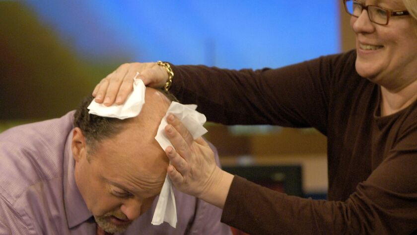"""No loss of volatility here. Jim Cramer, the host of CNBC's """"Mad Money,"""" gets wiped down after taping a show in 2005."""