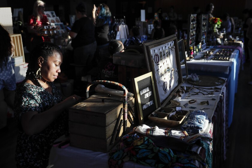 May Salem sells her Native Sol handmade jewelry and clothes at Mujeres Market.