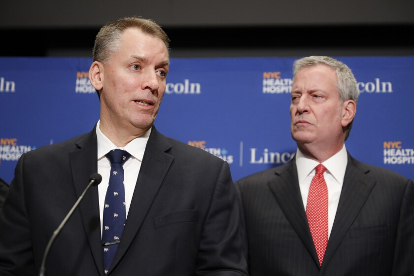 FILE - In a Sunday, Feb. 9, 2020 file photo, New York City Police Commissioner Dermot Shea, left, speaks alongside Mayor Bill de Blasio during a news conference in New York. New York City's police department is disbanding NYPD's anti-crime unit, the controversial unit involved in Eric Garner's 2014 chokehold death, Commissioner Dermot Shea said Monday, June 15, 2020 amid a nationwide reckoning for policing in the wake of George Floyd's death last month in Minneapolis .(AP Photo/John Minchillo, File)