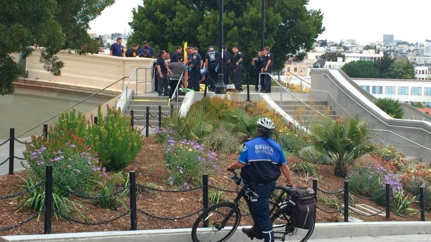 San Francisco Police officers and paramedics respond to a shooting at Dolores Park in San Francisco.