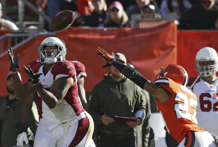 Arizona Cardinals wide receiver Michael Floyd (15) catches a touchdown pass in front of Cleveland Browns cornerback Joe Haden (23) in the second half of an NFL football game, Sunday, Nov. 1, 2015, in Cleveland. (AP Photo/Ron Schwane)