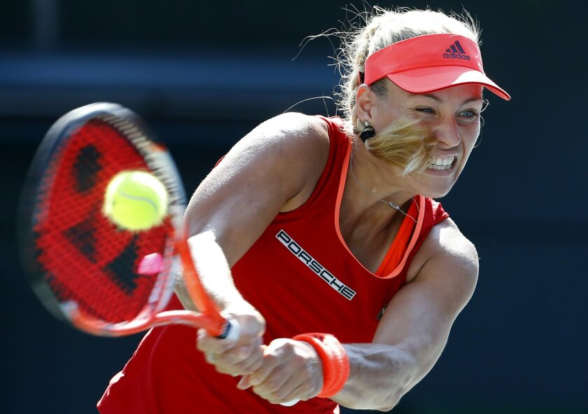 Angelique Kerber of Germany returns a shot against Daria Gavrilova of Russia during a first round match of the Pan Pacific Open women's tennis tournament in Tokyo, Tuesday, Sept. 22, 2015. (AP Photo/Shizuo Kambayashi)