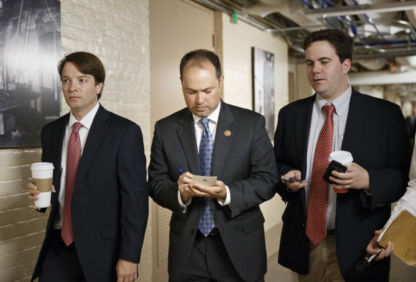 Rep. Marlin Stutzman (R-Ind.), center, walks through a basement corridor at the U.S. Capitol in Washington on Wednesday.