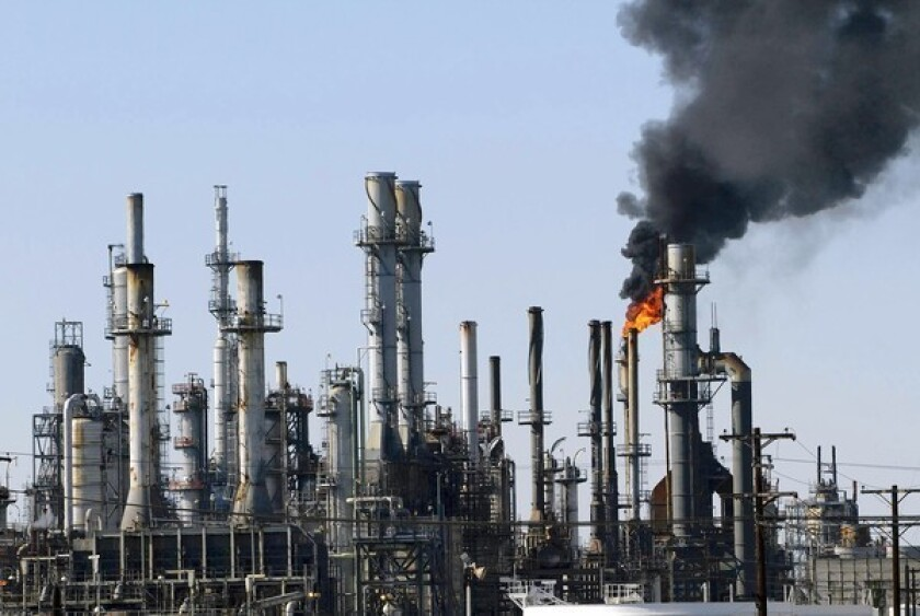 """Black smoke rises from the ConocoPhillips oil refinery in Los Angeles. President Obama and GOP candidate Mitt Romney tout an """"all-of-the-above"""" energy strategy, but the candidates emphasize different fuels."""