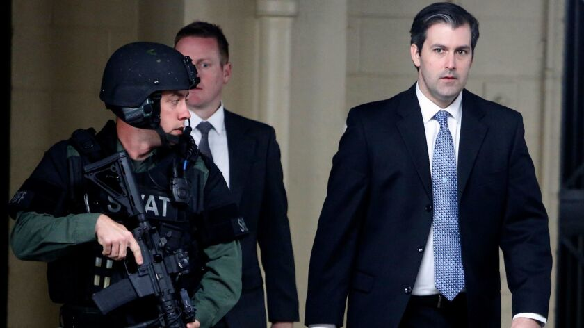 Michael Slager walks from the Charleston County Courthouse under the protection of the Charleston County Sheriff's Department, after a mistrial was declared for his trial in Charleston, S.C. on Dec. 5.