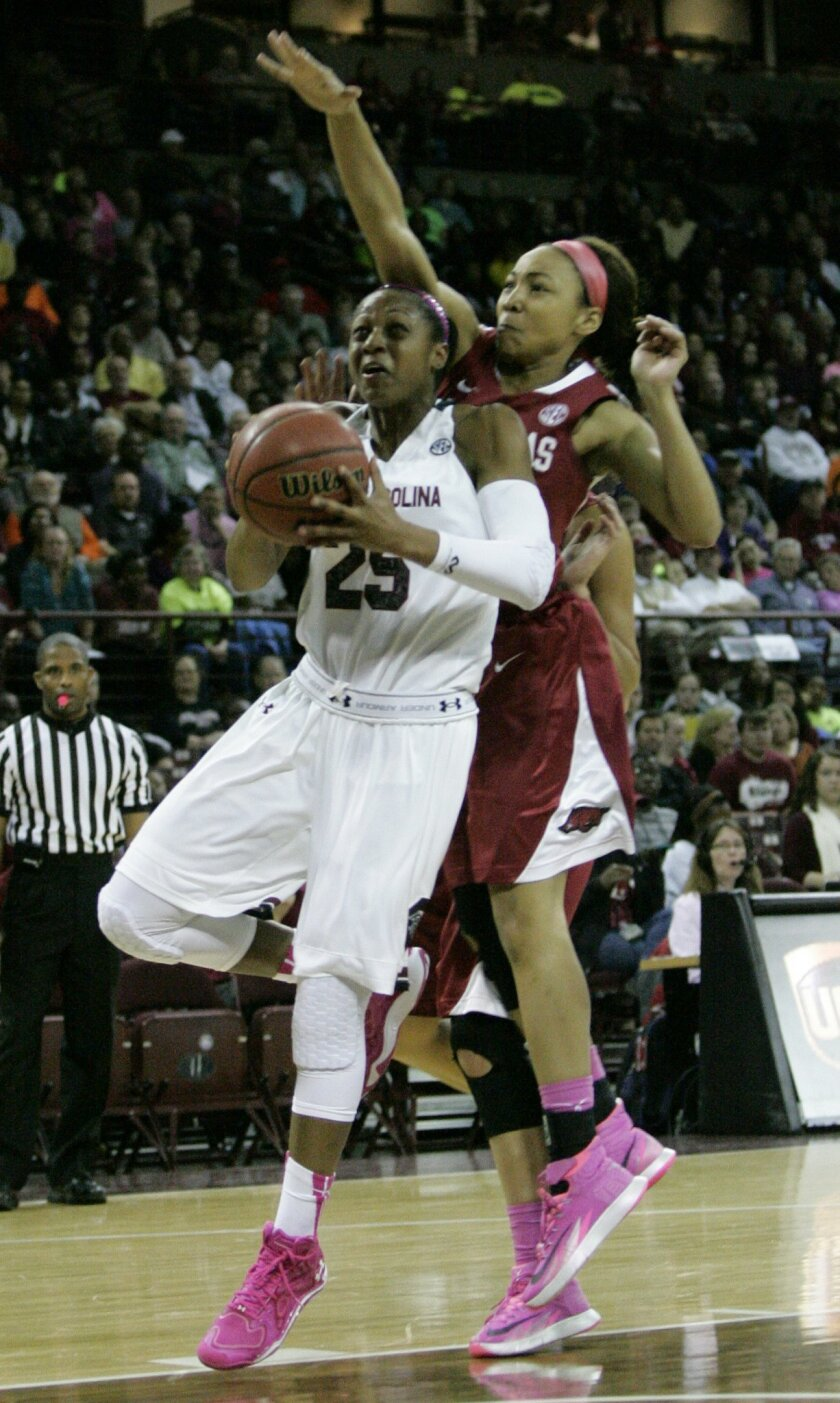 South Carolin's Tiffany Mitchell drives for the basket as Arkansas's Jessica Jackson is called for the foul as she tries to block the shot during an NCAA college basketball game on Sunday, Feb. 9, 2014, in Columbia, S.C. (AP Photo/Mary Ann Chastain)
