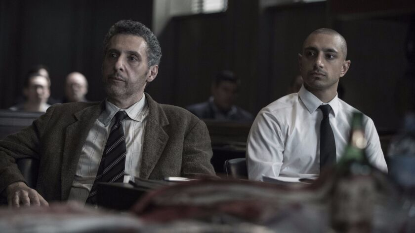 """This image released by HBO shows John Turturro, left, and Riz Ahmed in """"The Night Of."""" The program w"""