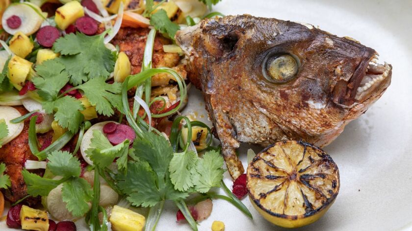 LOS ANGELS, CA - JANUARY 23, 2019 - Whole Snapper, with escabeche, lime, pineapple and cilantro, ser
