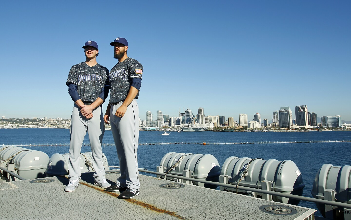 SAN DIEGO, CA -NOVEMBER 29, 2015 - Padres Wil Myers, left, pitcher James Shields unveils the team's new blue digital camouflage tops which are modeled after the US Navy's working uniforms, often called blueberries. . They are shown here at a news conference aboard the aircraft carrier USS Theodore Roosevelt. (K.C. Alfred/ San Diego Union-Tribune)