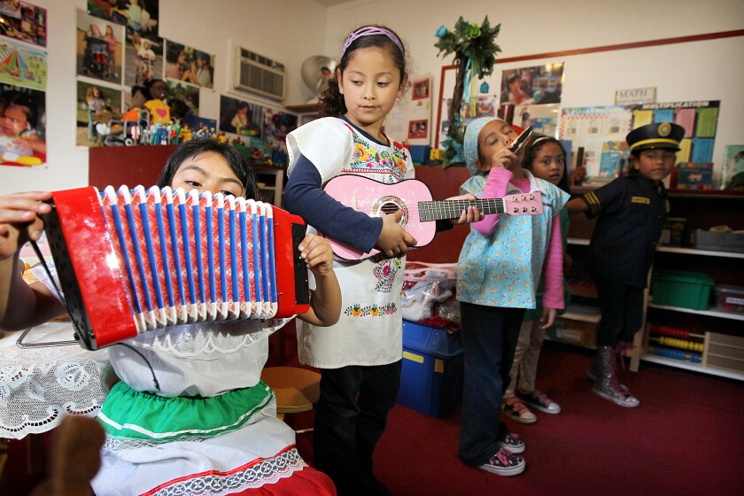 Children play at Ramona's Day Care in Long Beach. More than 113,000 young Latinos in California weren't counted in the 2010 census, a new study says, with 47,000 of them in Los Angeles County.