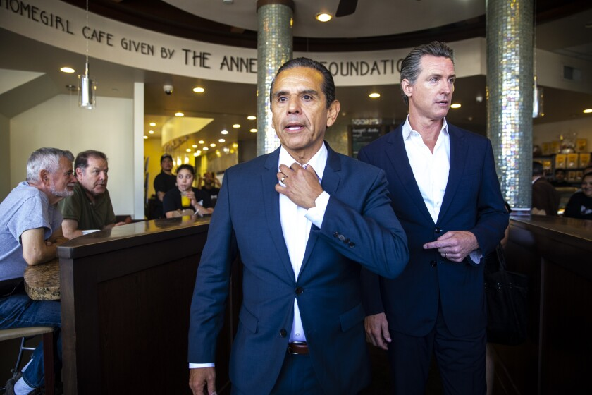 LOS ANGELES, CALIF. - JUNE 19: Former Los Angeles Mayor Antonio Villaraigosa and California Lt. Governor Gavin Newsom walk out to speak at a press conference in front of Homegirl Cafe on Tuesday, June 19, 2018 in Los Angeles, Calif. (Kent Nishimura / Los Angeles Times)