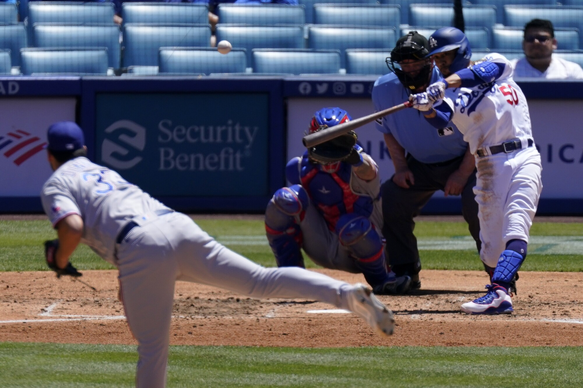 Dodgers right fielder Mookie Betts hits a solo home run off Texas Rangers starting pitcher Dane Dunning.