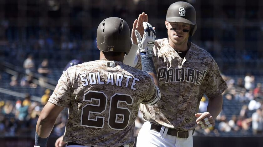 The Padres' Wil Myers is congratulated by Yangervis Solarte after hitting a solo home run during the first inning of a baseball game against the Colorado Rockies at Petco Park on Sept. 24, 2017 in San Diego.