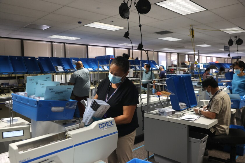 Workers sort mail-in-ballots at the Santa Clara County registrar of voters office on Aug. 25 in San Jose.