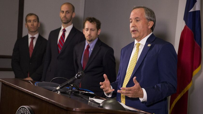 Texas Atty. Gen. Ken Paxton speaks about a lawsuit he filed against the federal government to end DACA during a news conference May 1 in Austin, Texas.