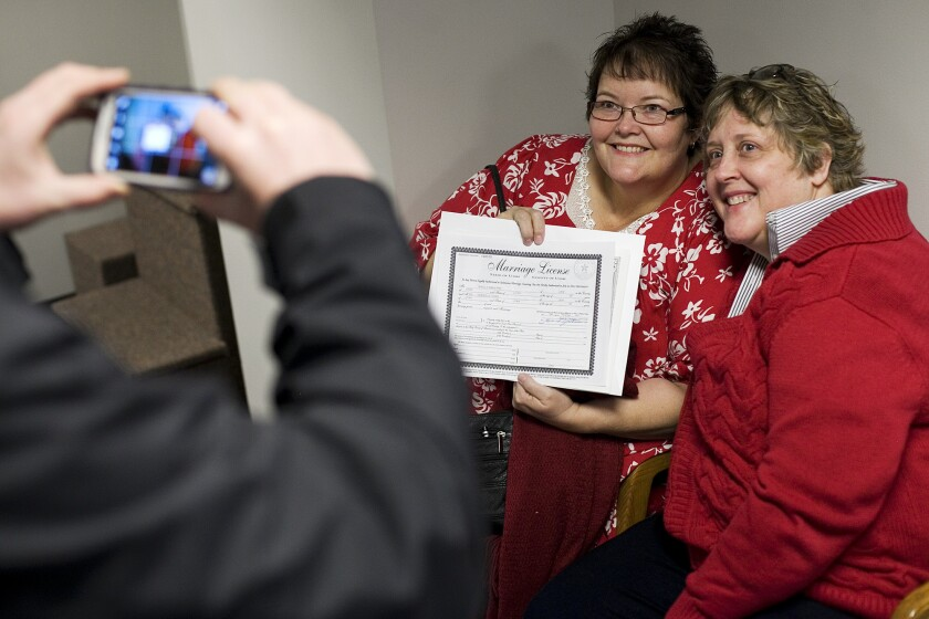 Cheryl Haws, right, and her partner Shelly Eyre have their photograph taken after receiving their marriage license at the Utah County clerk's office in Provo, Utah.