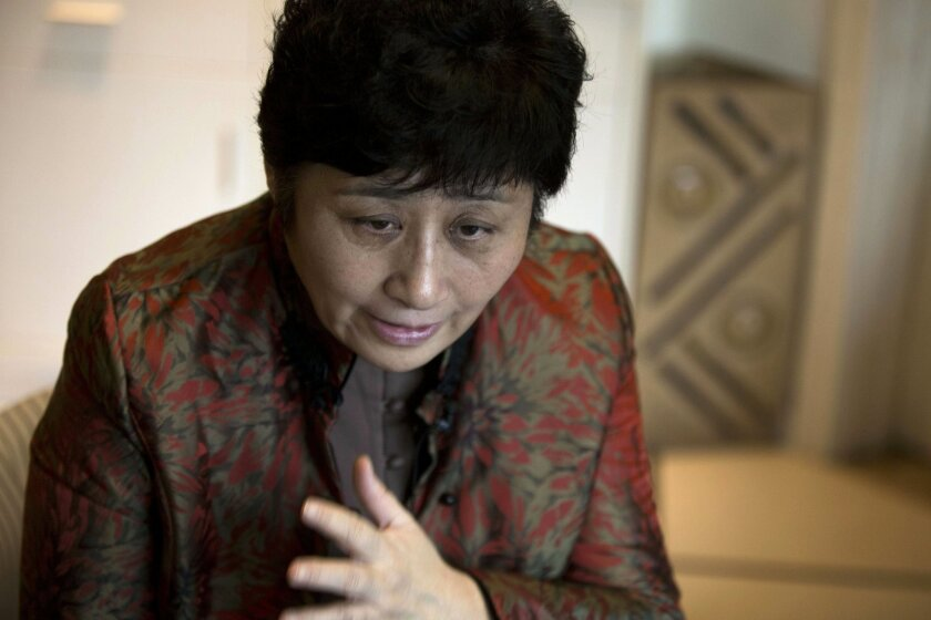 In this photo taken Wednesday, Nov. 6, 2013, Wang Ying speaks during an interview at her home in Beijing, China. Wang, who was a low-profile member of China's business elite for years, is now a leading voice among entrepreneurs troubled by the growing ranks of business owners who have suffered unde