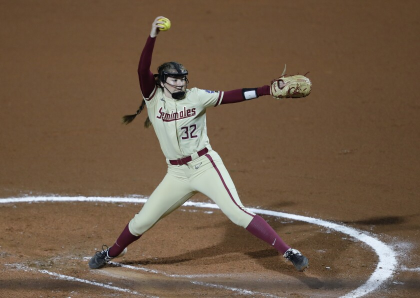 Florida State's Kathryn Sandercock (32) delivers a pitch to Oklahoma State in the first inning of an NCAA women's College World Series softball game on Saturday, June 5, 2021, in Oklahoma City. (AP Photo/Alonzo Adams)