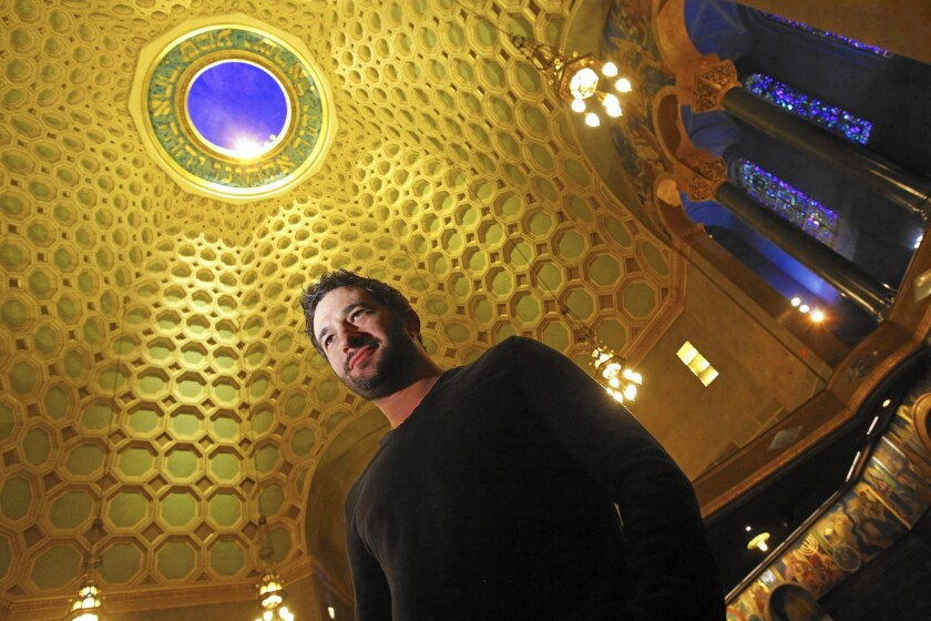 "Aaron Wolf poses in the sanctuary of the Wilshire Boulevard Temple in Los Angeles. His documentary ""Restoring Tomorrow"" tells about the restoration of the temple."