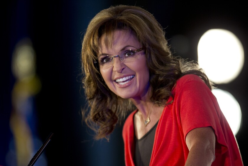 """Fox News commentator Sarah Palin, shown in June 2013, says President Obama's """"mom jeans"""" signal weakness to Russian President Vladimir Putin."""