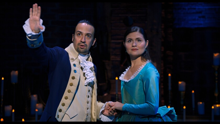 """Lin-Manuel Miranda and Phillipa Soo, in costume in """"Hamilton,"""" look out into the audience."""