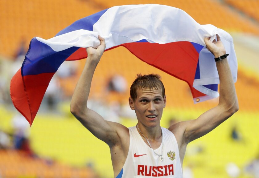 FILE In this file photo taken on Wednesday, Aug. 14, 2013, Russia's Mikhail Ryzhov celebrates winning silver with the men's 50 kilometer race walk at the World Athletics Championships in the Luzhniki stadium in Moscow, Russia. Eight Russian doping cases will be decided by the Court of Arbitration for Sport while Russia remains suspended from global track and field. Among them are walkers including reigning European champion of 2013 world championship silver medalist Mikhail Ryzhov.(AP Photo/Anja Niedringhaus, file)