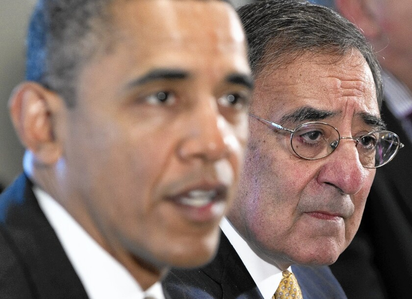 """President Obama and then-Defense Secretary Leon E. Panetta in 2012. Panetta says in his new book that Obama """"avoids the battle, complains and misses opportunities."""""""