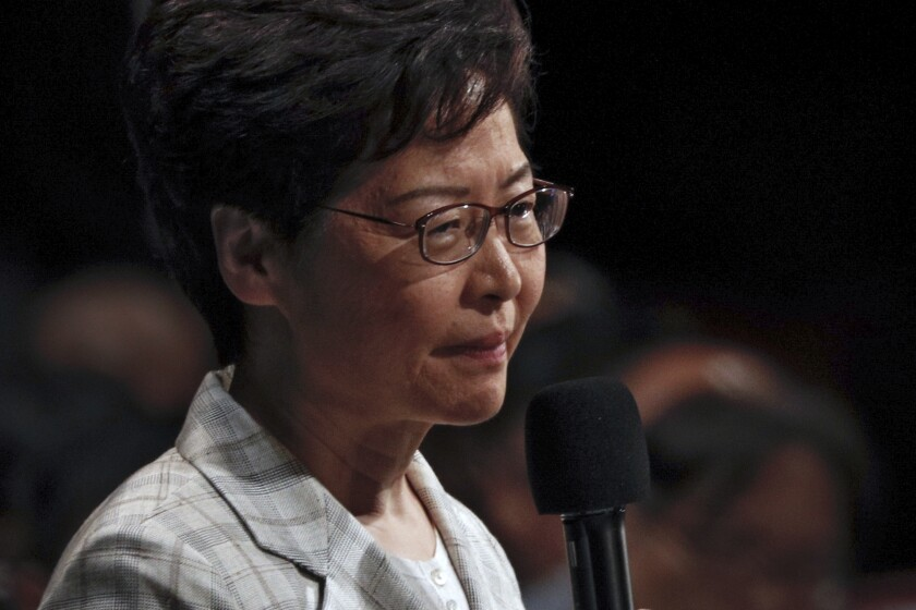 Hong Kong Chief Executive Carrie Lam speaks during a community dialogue with selected participants at the Queen Elizabeth Stadium in Hong Kong, Thursday, Sept. 26, 2019. Scores of protesters chanted slogans outside a stadium in downtown Hong Kong as embattled city leader Carrie Lam began a town hall session Thursday aimed at cooling down months of demonstrations for greater democracy in the semi-autonomous Chinese territory. (AP Photo/Kin Cheung)
