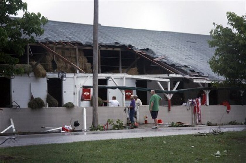 People access damage at barn 40 int Churchill Downs after storms passed through the area in Louisville, Ky., Wednesday, June 22, 2011. (AP Photo/The Courier-Journal, Pam Spaulding) NO SALES, NO ARCHIVE, MAGS OUT