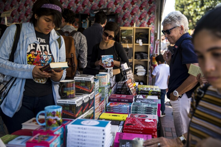 People browse books for sale during the 2018 Los Angeles Times Festival of Books.