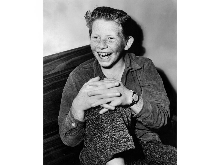 """Feb. 10, 1953: Jimmy Boyd, 14, sits in a courthouse for a hearing with a judge to change his professional contracts following the success of his 1952 hit song, """"I Saw Mommy Kissing Santa Claus."""""""