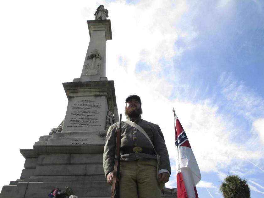 FILE - In this July 10, 2017, file photo, Cameron Maynard stands at attention by the monument to Confederate soldiers at the South Carolina Statehouse in Columbia, S.C. The South Carolina Supreme Court has upheld a 2000 law protecting Confederate monuments from being moved without a vote from the General Assembly. (AP Photo/Jeffrey Collins, File)