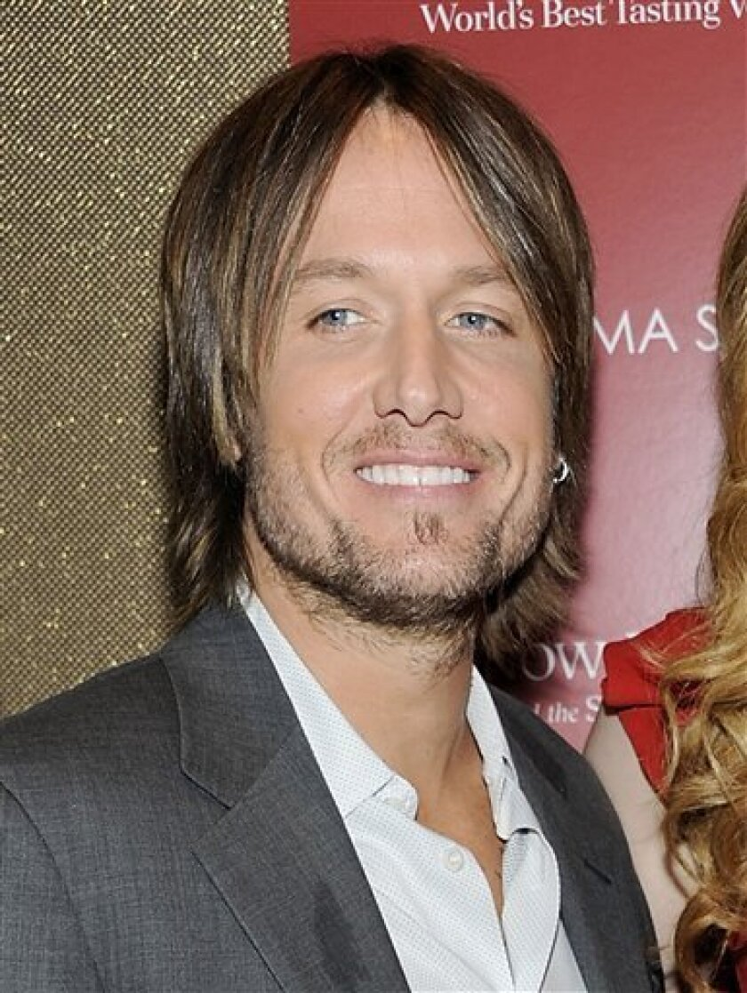 """FILE - In this July 13, 2011 file photo, country singer Keith Urban attends a special screening of """"Snow Flower and the Secret Fan"""" in New York. Urban will perform at the Grand Ole Opry on Feb. 3. It is his first public performance since undergoing vocal surgery. (AP Photo/Evan Agostini, file)"""