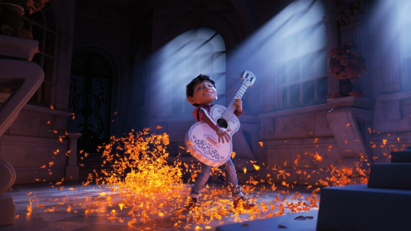 "Miguel, voiced by newcomer Anthony Gonzalez, dreams of becoming an accomplished musician in the animated movie ""Coco."""