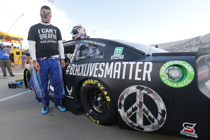Driver Bubba Wallace prepares for the NASCAR Cup series race with his newly painted Black Lives Matter car on June 10, 2020.