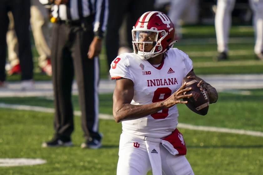 Indiana quarterback Michael Penix Jr. looks for a receiver during the second quarter of the team's NCAA college football game against Rutgers, Saturday, Oct. 31, 2020, in Piscataway, N.J. (AP Photo/Corey Sipkin)