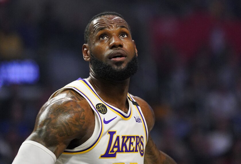 Lakers forward LeBron James watches for a rebound.